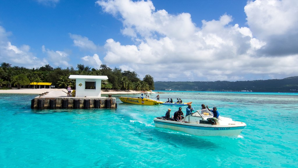 Saipan which includes boating and general coastal views as well as a small group of people