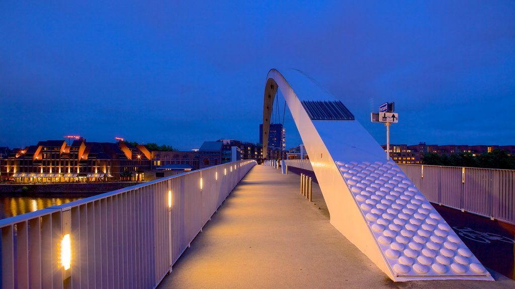 Maastricht featuring a bridge, night scenes and modern architecture