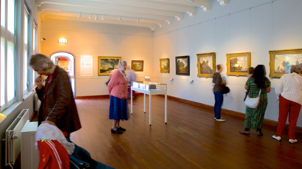 Frans Hals Museum showing interior views and art as well as a large group of people