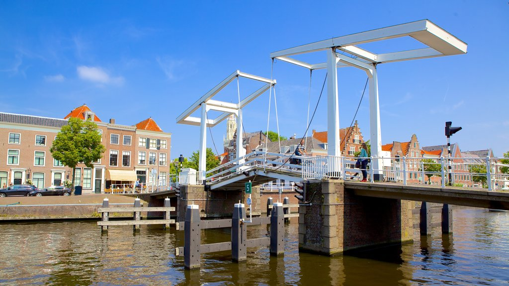 Haarlem which includes a river or creek and a bridge