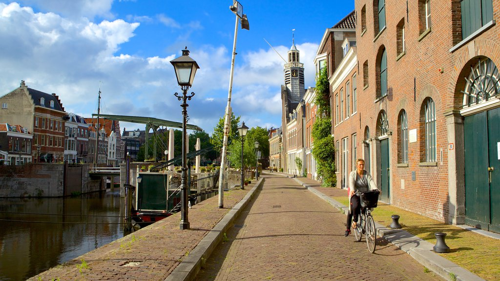 Delfshaven showing street scenes and cycling as well as an individual femail