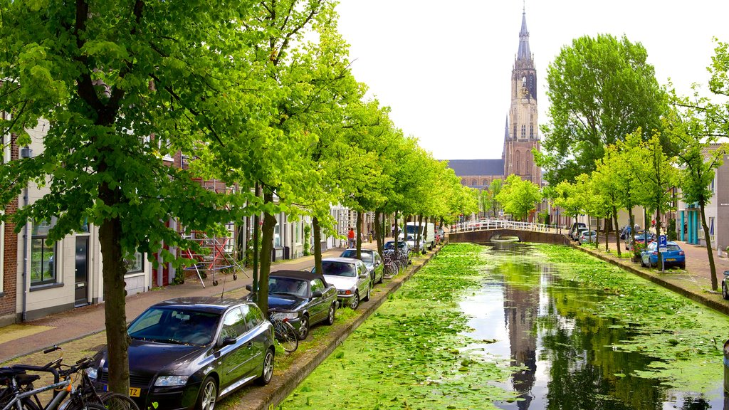 Delft showing a river or creek and street scenes
