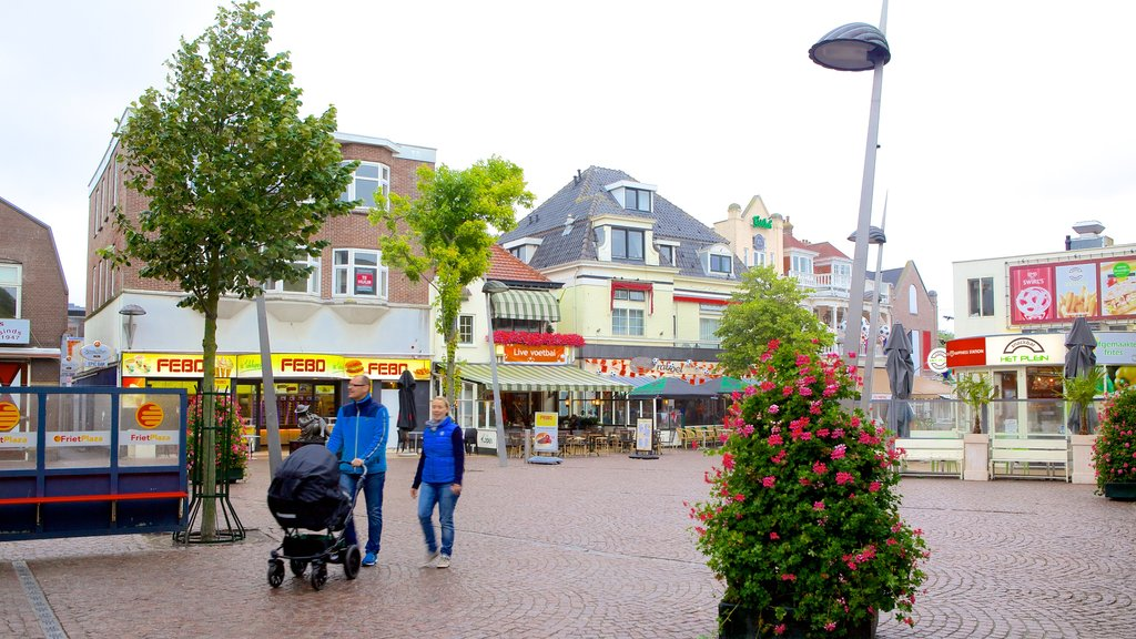 Zandvoort featuring street scenes as well as a small group of people