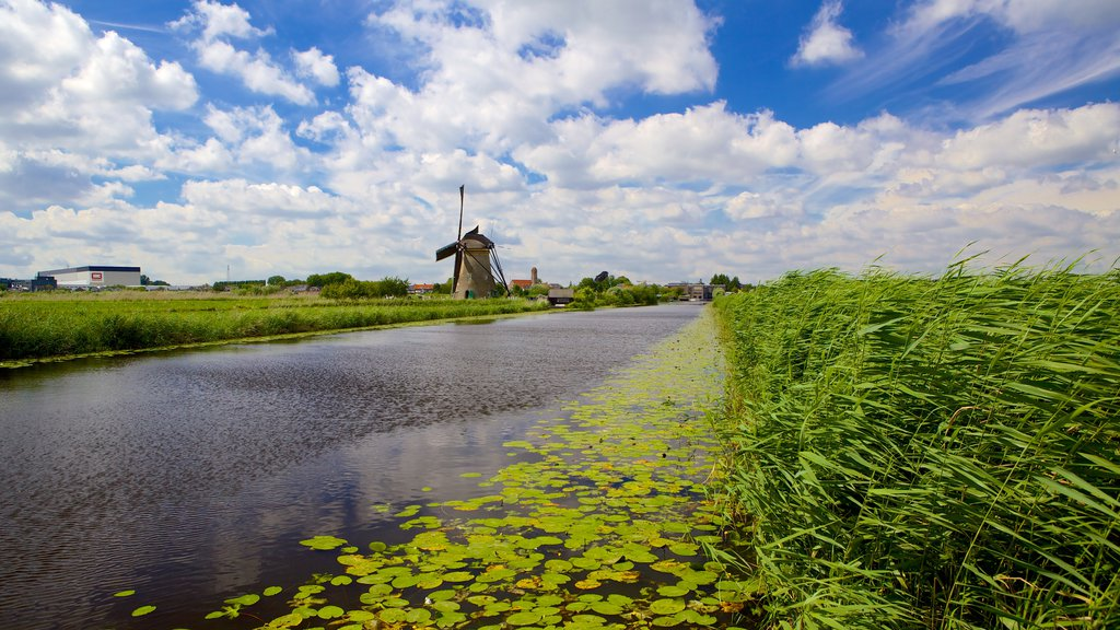 Kinderdijk showing a river or creek and wetlands