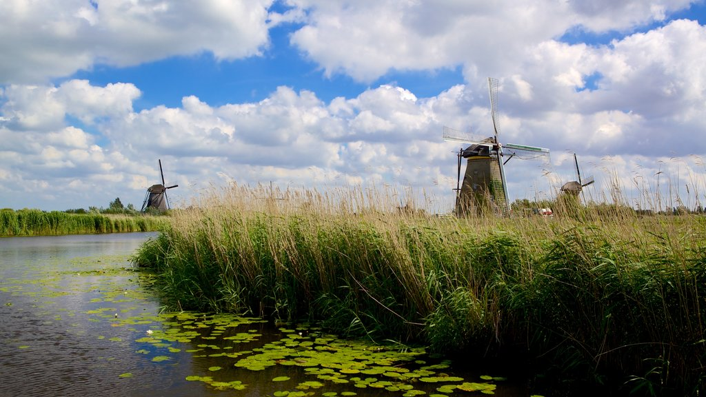 Kinderdijk which includes a windmill, wetlands and a river or creek