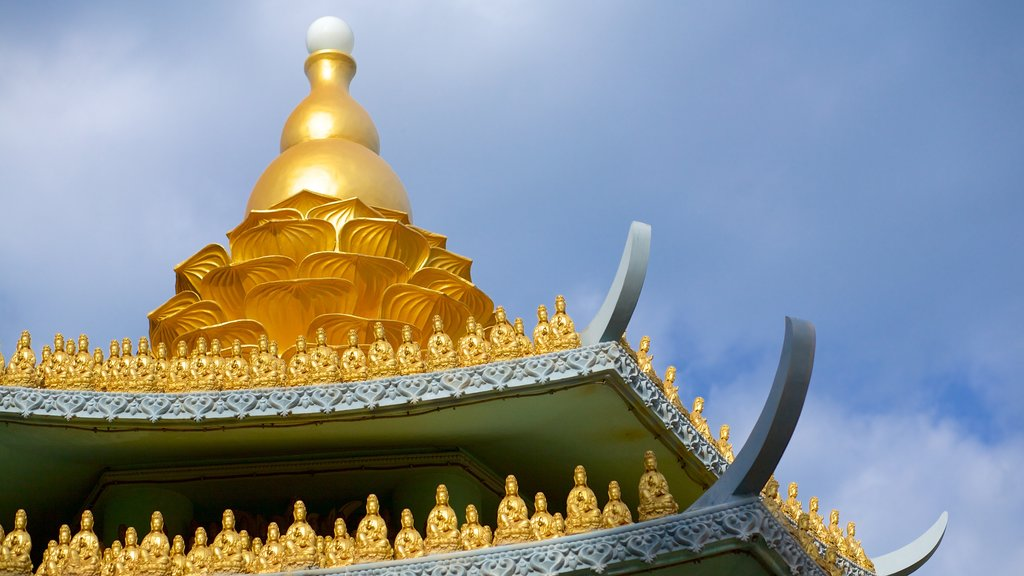 Linh Son Co Tu which includes heritage architecture, religious aspects and a temple or place of worship