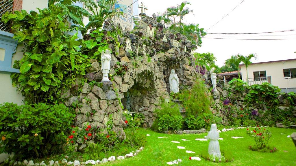 Iglesia Don Rua featuring a garden and a statue or sculpture