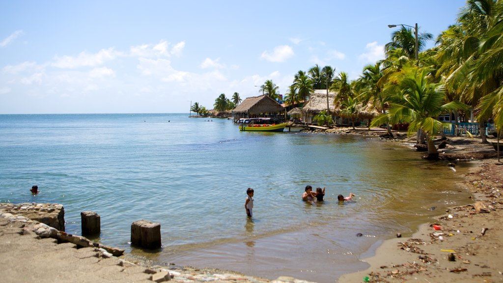 Omoa showing general coastal views and swimming as well as children