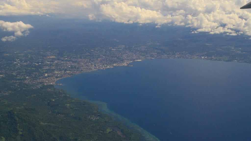 Manado which includes a city and general coastal views