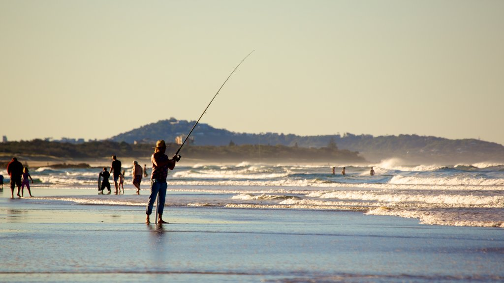 Alex Beach which includes a sandy beach and fishing as well as a large group of people