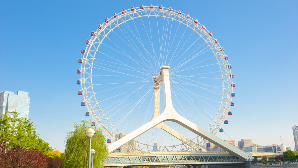 Tianjin Eye showing rides and modern architecture