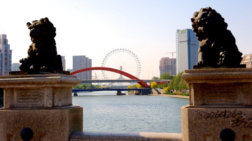 Tianjin Eye showing a bridge, a river or creek and a city