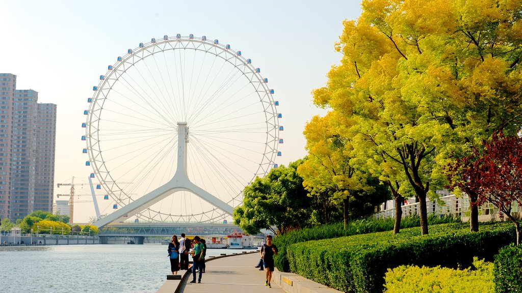 Tianjin Eye which includes street scenes, rides and a river or creek