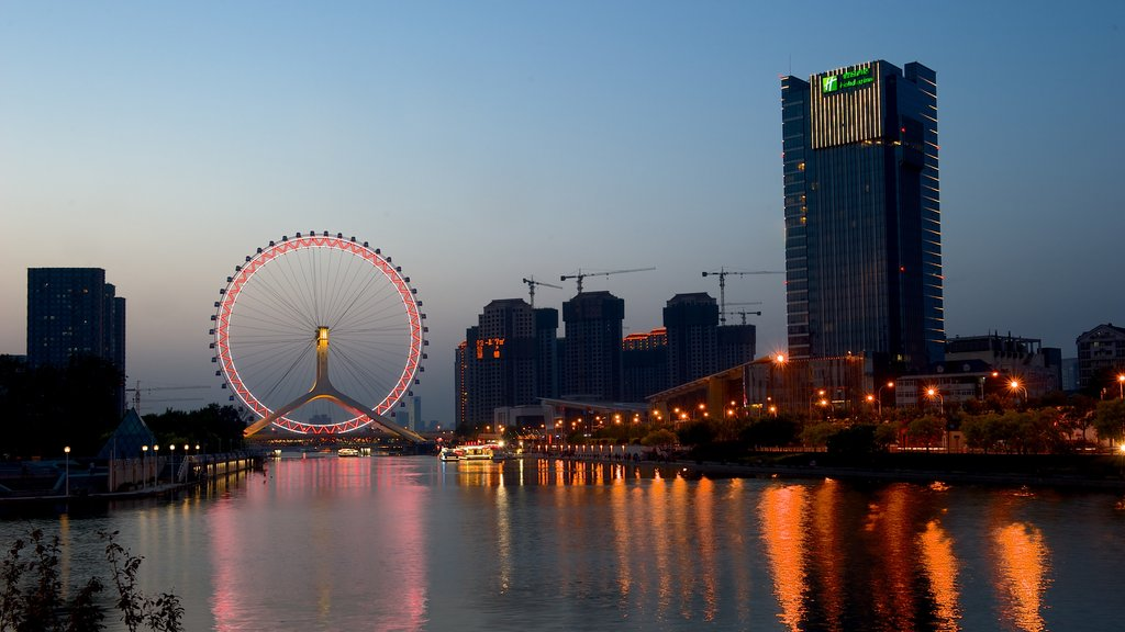 Tianjin Eye showing central business district, a city and night scenes