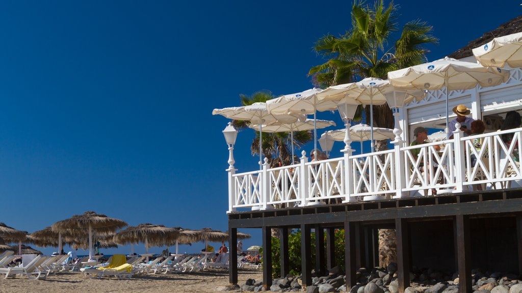 Adeje featuring a luxury hotel or resort and a sandy beach