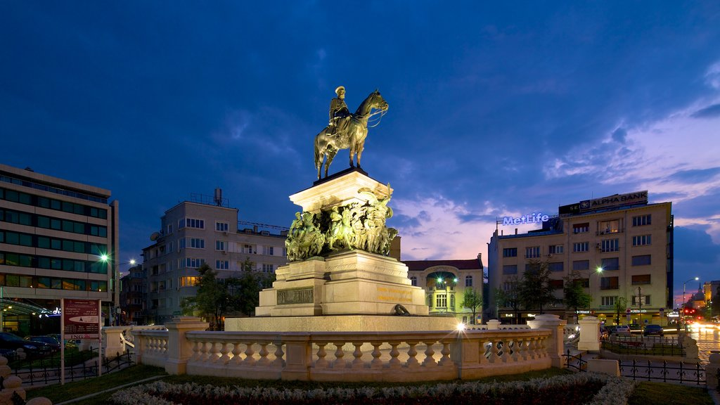 Monument to the Liberating Tsar showing a statue or sculpture and night scenes