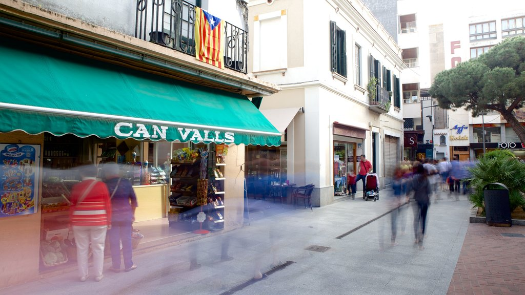 Lloret de Mar showing shopping and street scenes as well as a large group of people