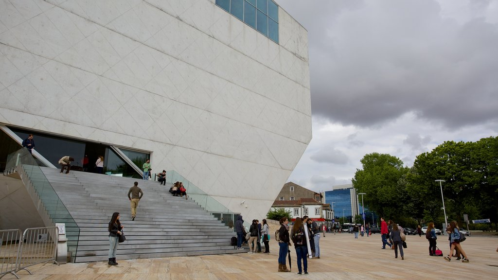 Casa da Musica featuring street scenes as well as a large group of people