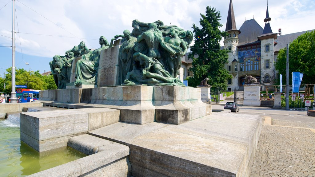 Bern Historical Museum featuring a statue or sculpture, outdoor art and a pond