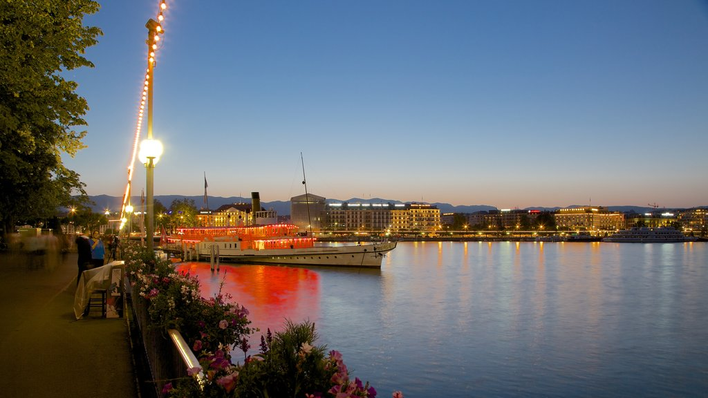 Geneva which includes night scenes, a lake or waterhole and a sunset