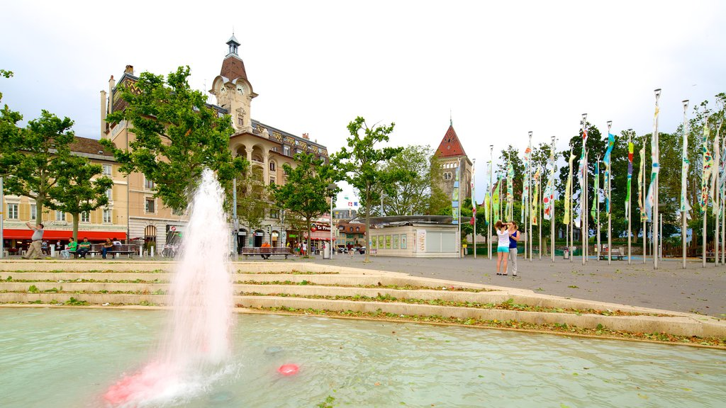 Lausanne which includes a fountain and a square or plaza
