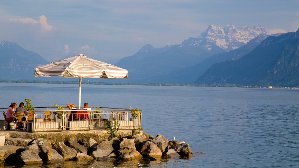 Vevey showing a lake or waterhole and outdoor eating