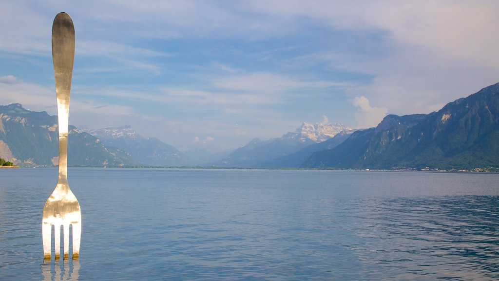 Vevey which includes a lake or waterhole and outdoor art