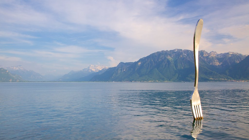 Vevey showing a lake or waterhole and outdoor art