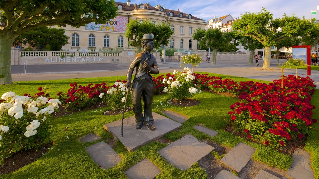 Vevey which includes a park, outdoor art and flowers