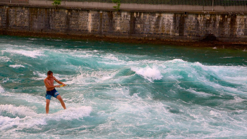 Thun featuring water skiing and waves as well as an individual male