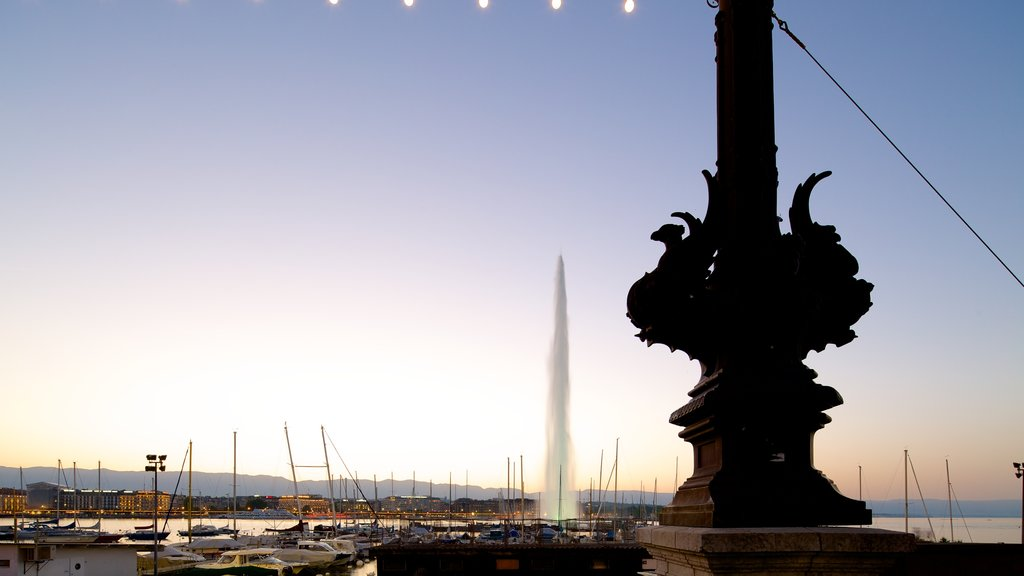 Jet d\'Eau Fountain showing a fountain, a marina and a sunset