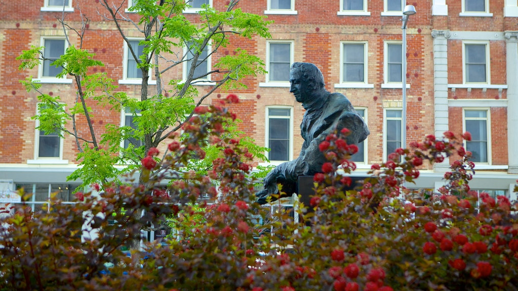 Guelph showing a statue or sculpture and flowers