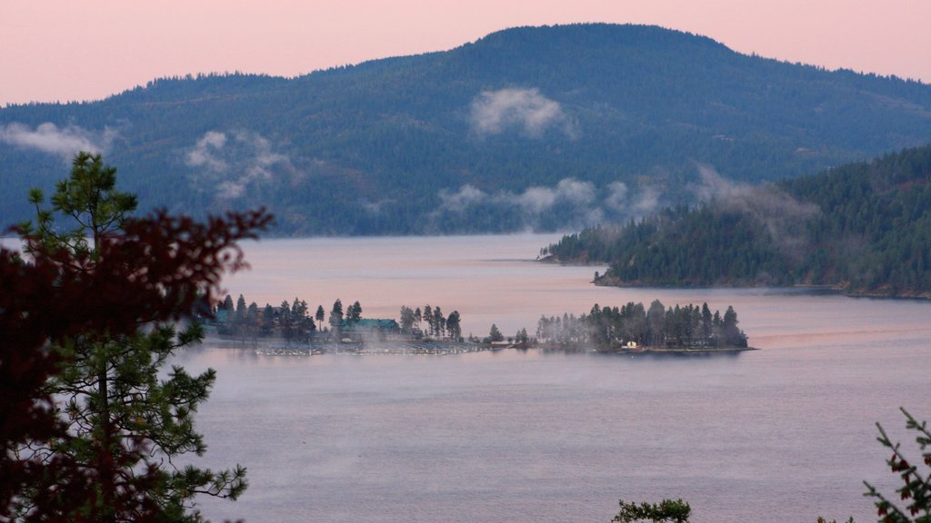 Coeur d\'Alene showing a lake or waterhole, mist or fog and a sunset