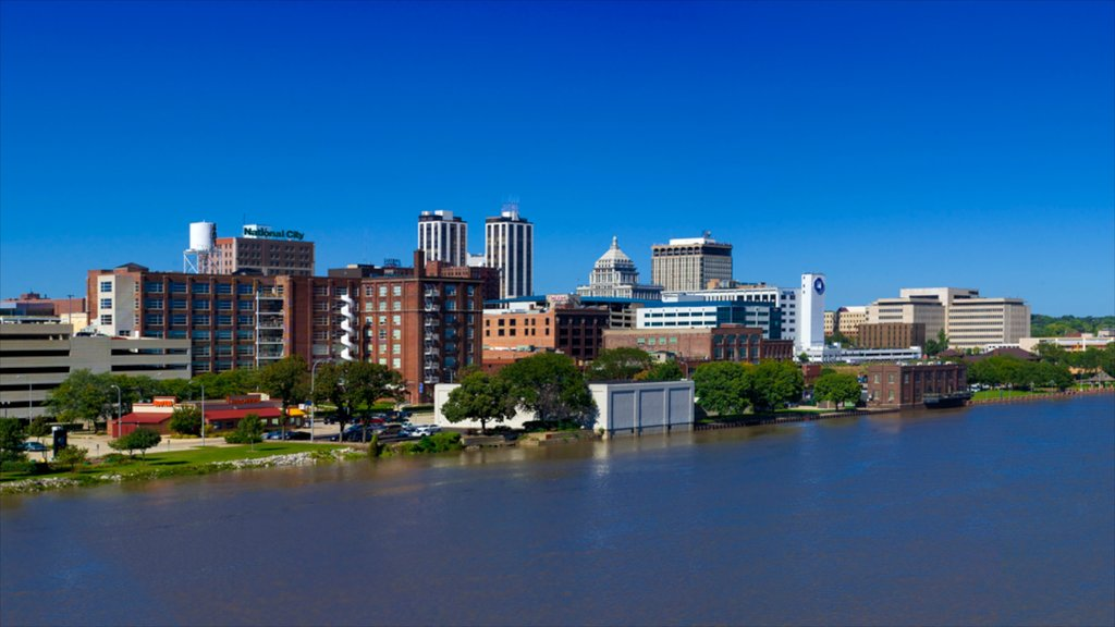 Peoria featuring a lake or waterhole, skyline and a city