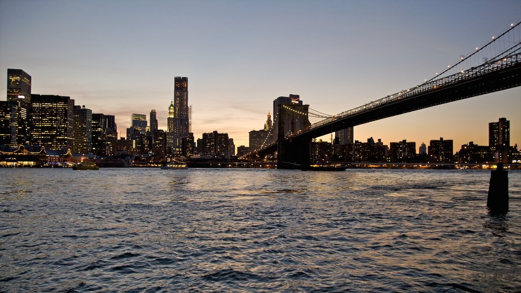 Brooklyn Bridge showing a sunset, a bridge and a city