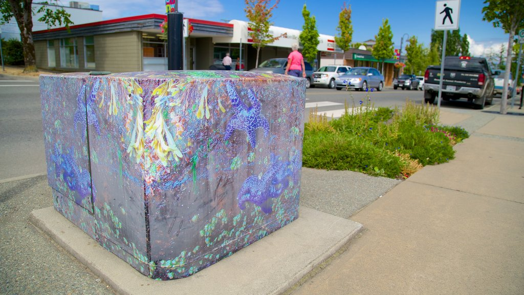 Parksville which includes outdoor art and street scenes