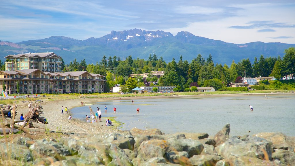 Parksville Beach featuring rocky coastline and a pebble beach