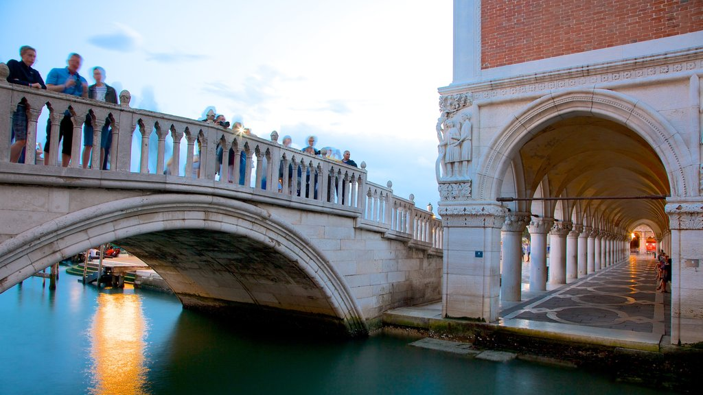 Bridge of Sighs showing heritage architecture, a sunset and a river or creek