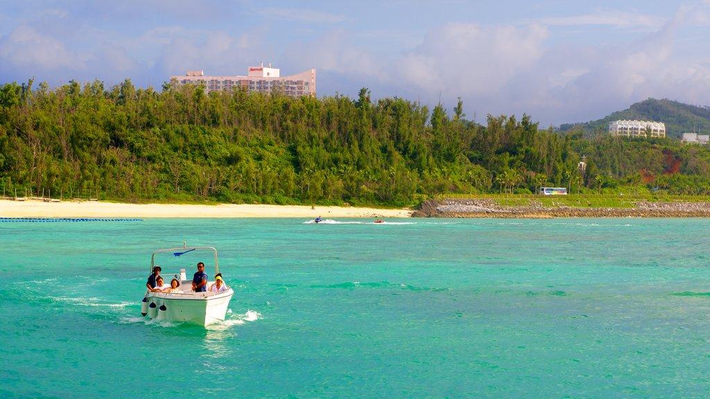 Parque Marino Busena que incluye paseos en lancha, una playa de arena y vistas generales de la costa