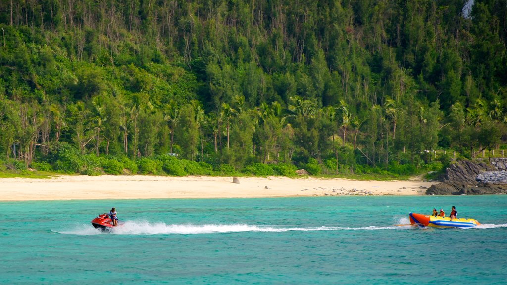 Busena Marine Park showing a beach, jet skiing and tropical scenes