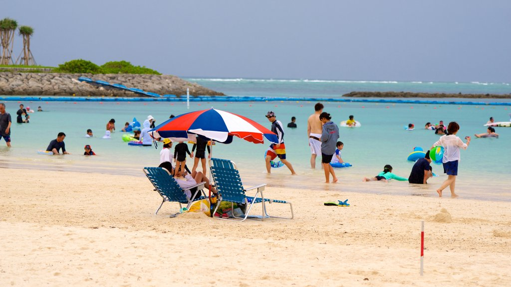 Okinawa which includes a sandy beach as well as a large group of people
