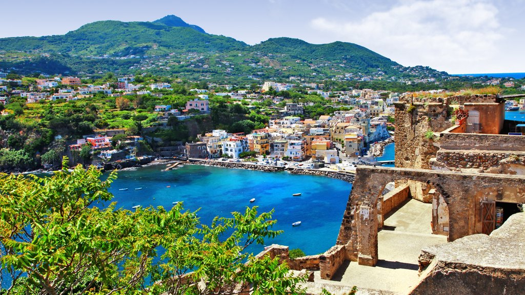 Ischia featuring building ruins, a coastal town and heritage architecture