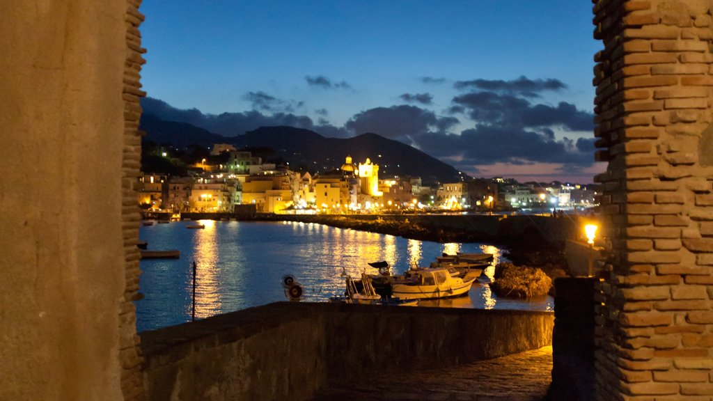 Ischia which includes night scenes, a river or creek and a coastal town