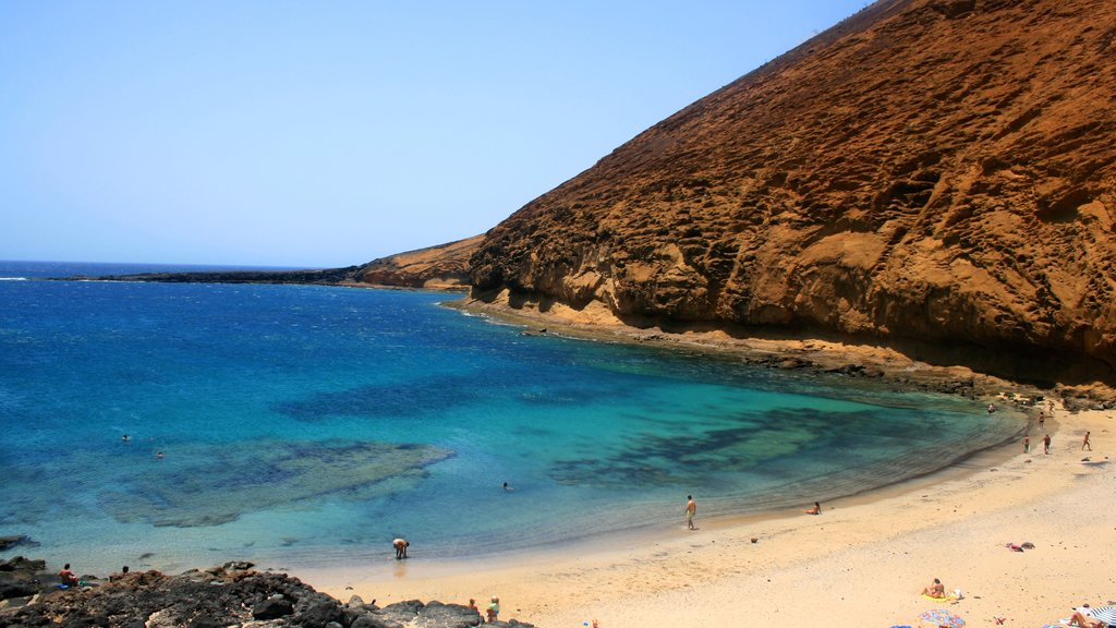 Lanzarote which includes a sandy beach and mountains