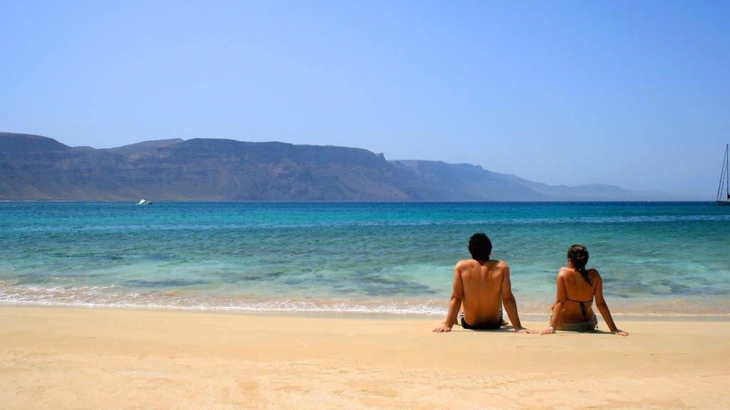 Lanzarote featuring a beach as well as a couple