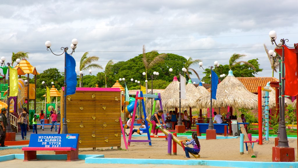 Managua which includes a playground as well as children