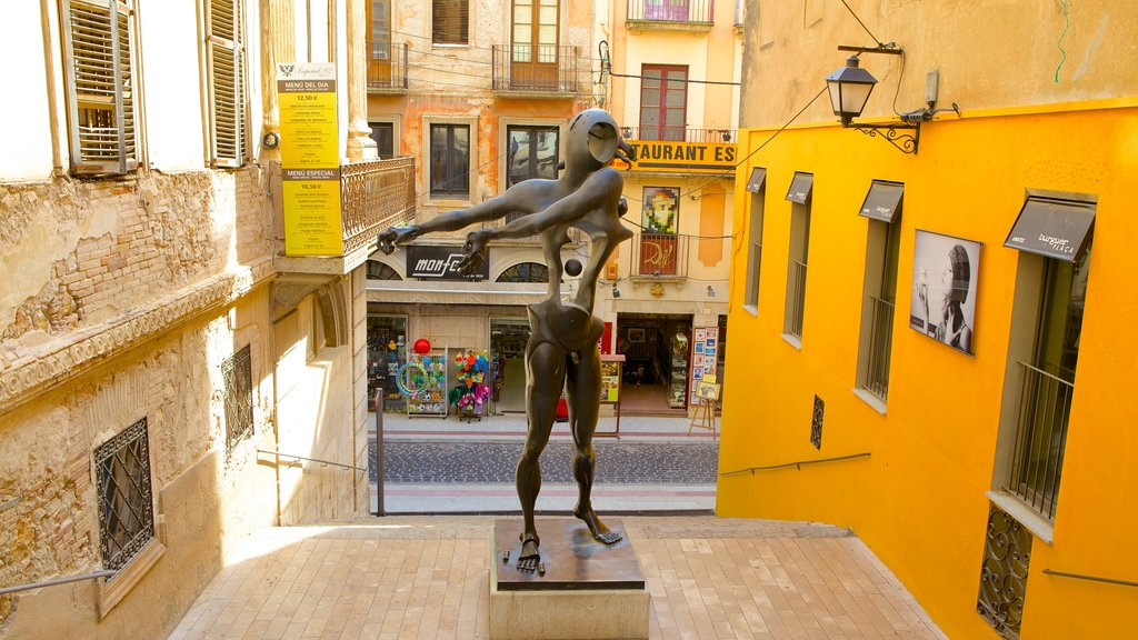 Figueres showing outdoor art, a statue or sculpture and street scenes