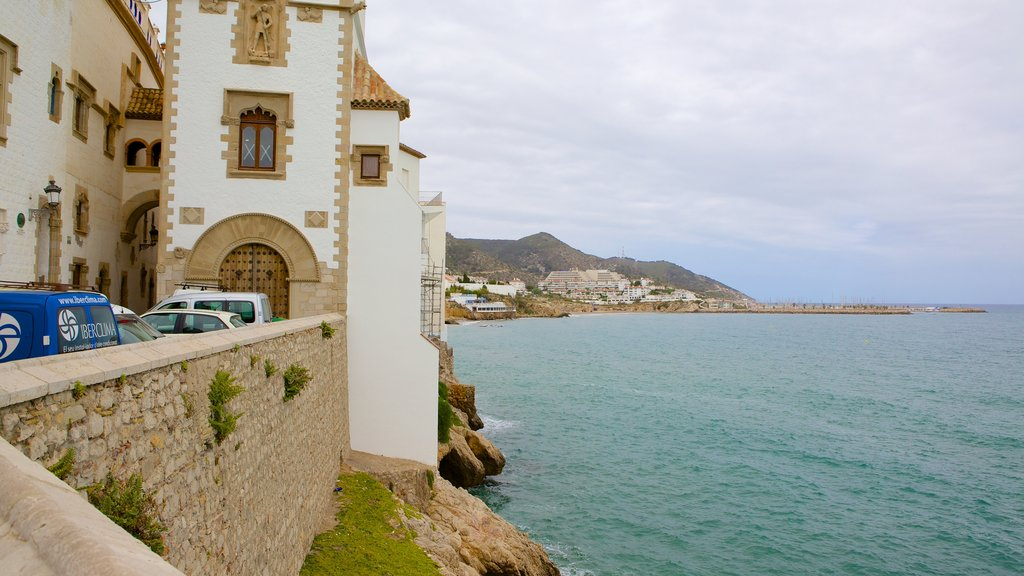 Sitges which includes rugged coastline and heritage architecture