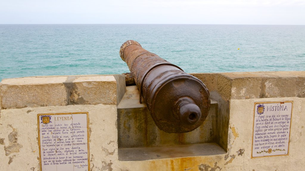 Sitges which includes military items and general coastal views