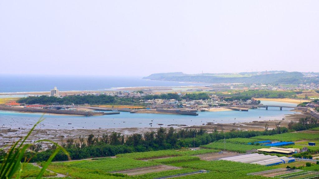 Okinawa featuring farmland and a bay or harbor